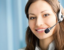 an image of a call-centre worker on the phone