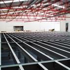 an image of the steel frame being prepared for a mezzanine floor placement