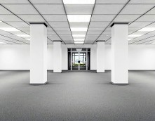 an image of an empty office space with a recently refurbished suspended ceiling