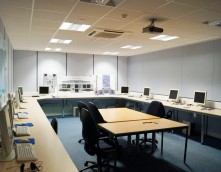 An image showing a long IT room that has undergone an office refurbishment by Wessex Interiors