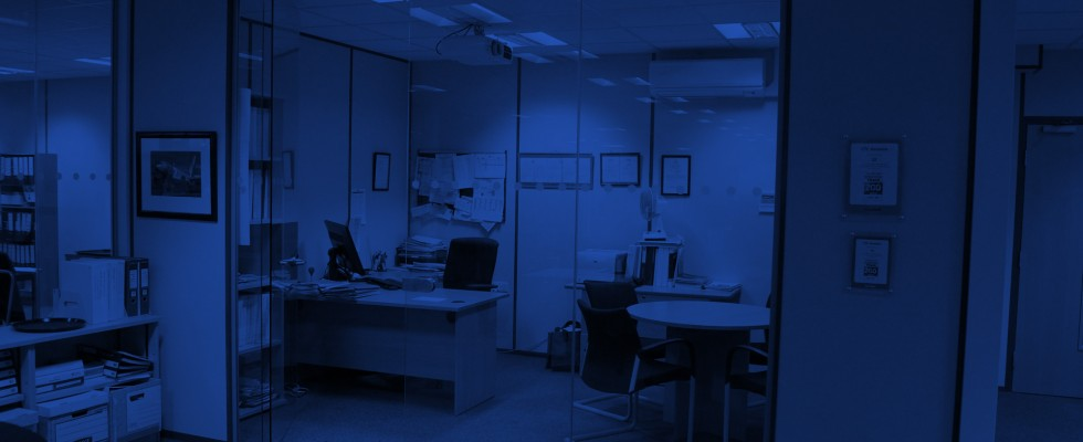 an image of an office partition installed by Wessex Interiors, overlaid in a blue hue to be used as a button on the website