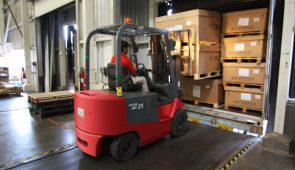 an image of a forklift being used in an industrial relocation